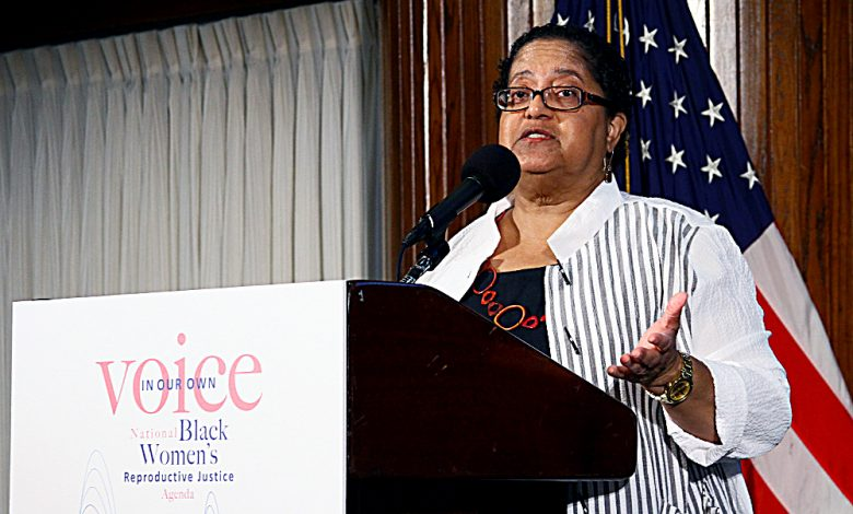 """Marcela Howell, founder and executive director of In Our Own Voice, presents the organization's """"Our Bodies, Our Lives, Our Voices"""" report on June 27 at the National Press Club in Northwest. The report was released """"to put forward a policy, leadership, and movement building agenda"""" for organizations working on women's issues specific to the black community. (E Watson/EDI)"""