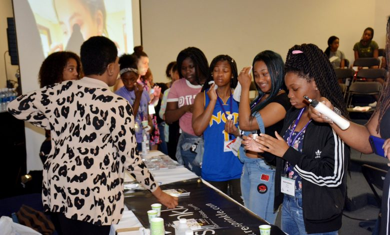 Young ladies practice removing makeup at the Red Sprinkle Fashion Boot Camp self-care beauty workshop during the We the Girls conference at Howard University in D.C. on June 3. (Roy Lewis/The Washington Informer)