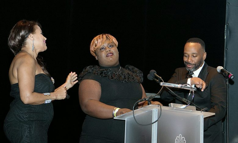"""Joe Clair (right) of """"The Joe Clair Morning Show"""" and Renee Allen (left) of the Women's Business Report present Dayonna Braddy with an award for her mini-documentary, """"The Perfect Child,"""" during the 2017 Richard Wright Gala at the Warner Theater on June 10. (Shevry Lassiter/The Washington Informer)"""