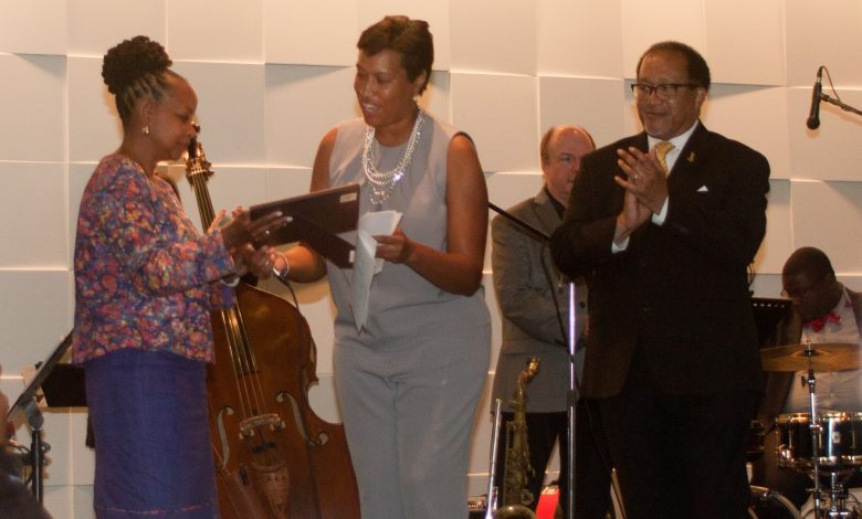 D.C. Mayor Muriel Bowser (center) presents a citation to NNPA Chair Denise Rolark Barnes, Publisher of the Washington Informer. Applauding at right is NNPA President and CEO Dr. Benjamin Chavis. (Photo by Elisabeth Ann Brown)