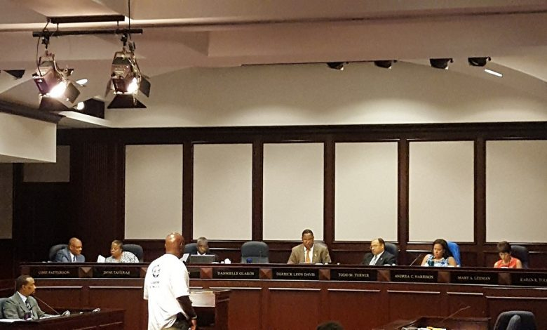 Anthony Garland (standing in center), international representative with the Amalgamated Transit Union, talks about Metro during a Prince George's County Council meeting in Upper Marlboro on June 13. (William J. Ford/The Washington Informer)
