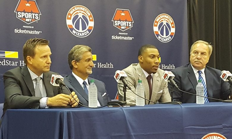 Washington Wizards small forward Otto Porter Jr. (second from right) speaks during a July 19 press conference at Verizon Center in D.C., joined by (from left) head coach Scott Brooks, owner Ted Leonsis and president Ernie Grunfeld. (William J. Ford/The Washington Informer)