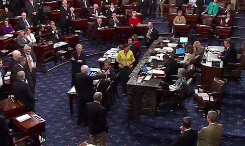 Sen. John McCain votes against the Senate bill to repeal the Affordable Care Act on July 28.