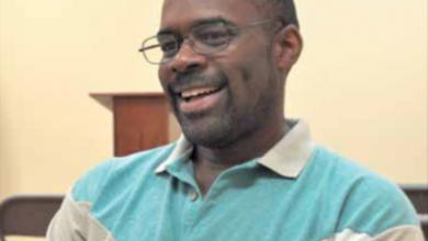 Photo of Volunteer Brings Black Press to Visually Impaired