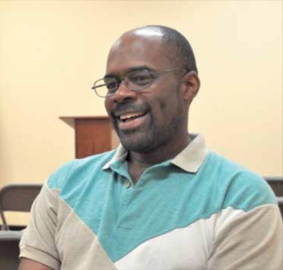 Metropolitan Washington Ear volunteer Mark Baker reads black-owned newspapers to the blind. (Courtesy photo)