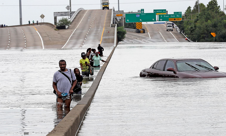 Residents of Houston walk along a major artery of the city as the waters from Tropical Storm Harvey continue to batter portions of the Gulf Coast region. (Courtesy photo)