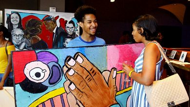"""Justin Lee, 20, discusses his artwork, titled """"Hands of Hope,"""" with the audience of the 2017 P.A.I.N.T.S. Arts Leadership Program Youth Arts Showcase, June 30 at the Howard Theatre in northwest D.C. Lee describes the hands in his work representing a prayer to God and hopes the piece will motivate others to believe that anything is possible when in communication with God. (E Watson/EDI Photo)"""