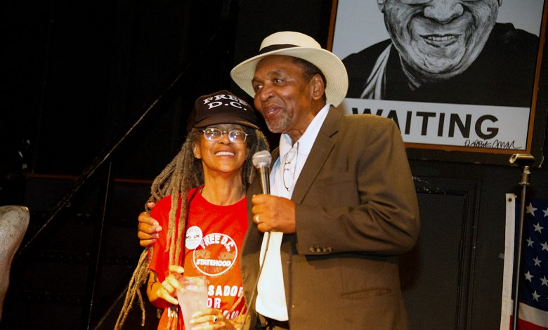 Anise Jenkins and Frank Smith share a moment during the Stand Up! for Democracy in DC Founders' Day event on Aug. 3. (Lateef Mangum/The Washington Informer)