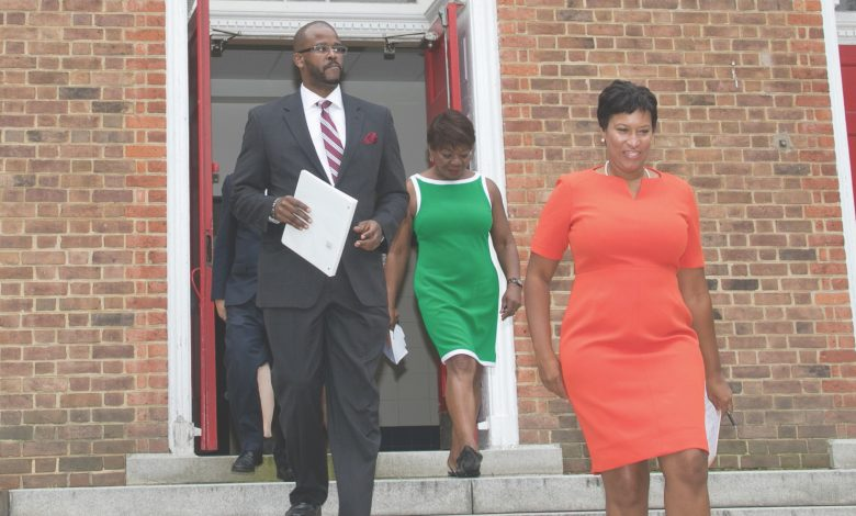 D.C. Mayor Muriel Bowser (right), Public Schools Chancellor Antwan Wilson (left) and Washington Teachers Union President Elizabeth Davis announce a tentative agreement for a new contract at Bunker Hill Elementary School in Northeast on Aug. 14. (Shevry Lassiter/The Washington Informer)