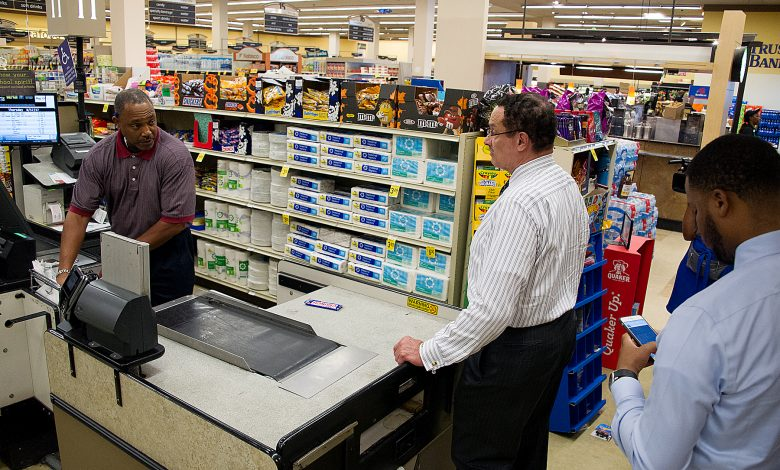 Ward 7 Council member Vincent Gray talks with a Safeway employee during a surprise inspection of the store in Southeast on Aug. 17. (Lateef Mangum/The Washington Informer)
