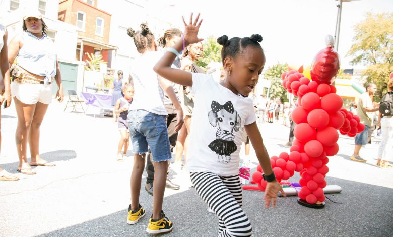 D.C. resident Samuela Griffiths dances in front of a small audience during a back-to-school festival at the Thurgood Marshall Center in northwest D.C. on Aug. 19. (Mark Mahoney/The Washington Informer)