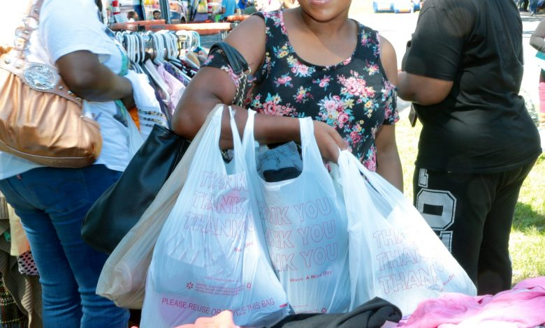 Tiffany Franklin picks up free children's clothing at the United Communities Against Poverty in Capitol Heights, Md. (Demetrious Kinney/The Washington Informer)