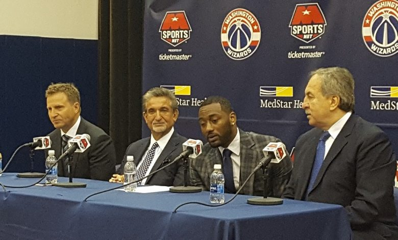 Washington Wizards All-Star point guard John Wall (second from right) speaks at a Aug. 4 press conference to discuss his contract extension to remain in D.C. for another six years. (William J. Ford/The Washington Informer)