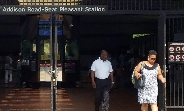 **FILE** Riders walk outside of Addison Road-Seat Pleasant Metro station on June 29. (William J. Ford/The Washington Informer)