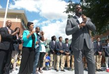 """Basketball legend Earvin """"Magic"""" Johnson speaks at the Back-to-School Block Party on Sept. 9 at Ron Brown College Preparatory High School in northeast D.C. (Shevry Lassiter/The Washington Informer)"""