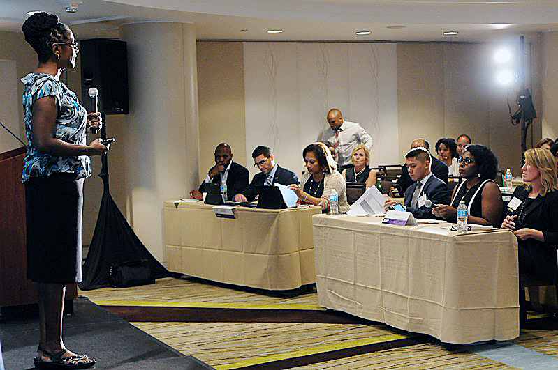 Dr. Charlene Brown, CEO of ReciproCare, addresses an audience at a D.C. event. (Courtesy photo)