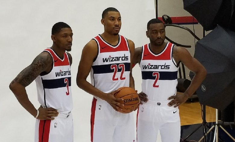 From left: The Washington Wizards' Bradley Beal, Otto Porter Jr. and John Wall pose for pictures during Media Day at Capital One Arena in northwest D.C. on Sept. 25. (William J. Ford/The Washington Informer)
