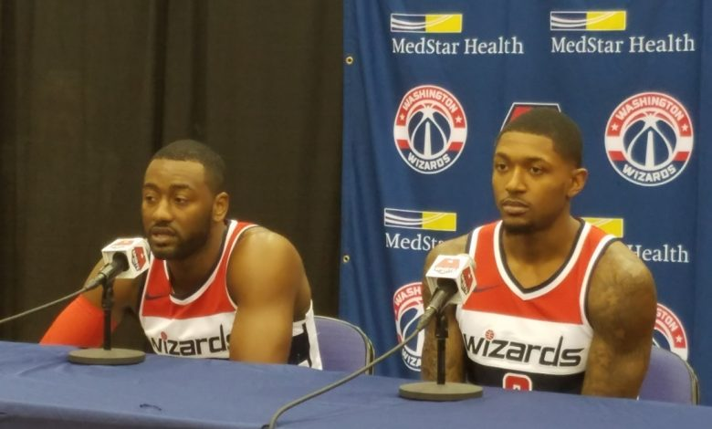 Washington Wizards guards John Wall (left) and Bradley Beal address reporters during media day at Capitol One Arena in northwest D.C. on Sept. 25. (William J. Ford/The Washington Informer)