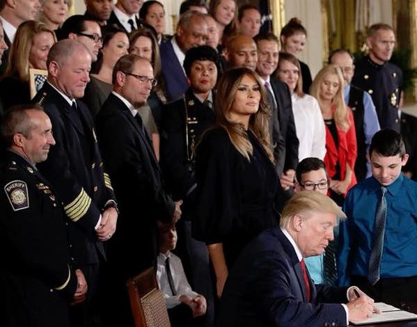 President Donald Trump signs a Presidential Memorandum declaring the opioid crisis a national health emergency during a news conference in the East Room of the White House on Oct. 26. (Courtesy of Trump via Facebook)