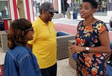 Donna Edwards (right) chats with Vann and Diane Jones of Upper Marlboro at Maryland's National Harbor on Oct. 5 after announcing earlier in the day that she will run for county executive. (William J. Ford/The Washington Informer)