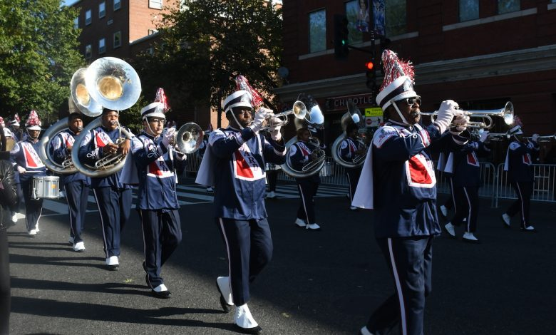 The Howard University marching band makes its way down Georgia Avenue in northwest D.C. during the university's homecoming parade on Oct. 21. (Roy Lewis/The Washington Informer)