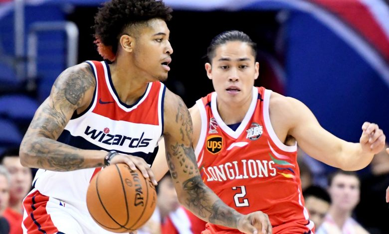 Washington Wizards forward Kelly Oubre Jr. drives past Guangzhou Long-Lions' Chen Yingjun in the first quarter of the Wizards' 126-96 win at Capital One Arena in northwest D.C. on Oct 2. (John E. De Freitas/The Washington Informer)