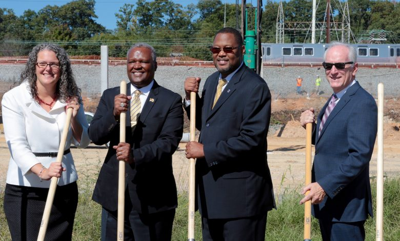 Officials pose after groundbreaking ceremony Oct. 4 to open a Kaiser Permanente building in New Carrollton, Maryland. (Demetrius Kinney/The Washington Informer)