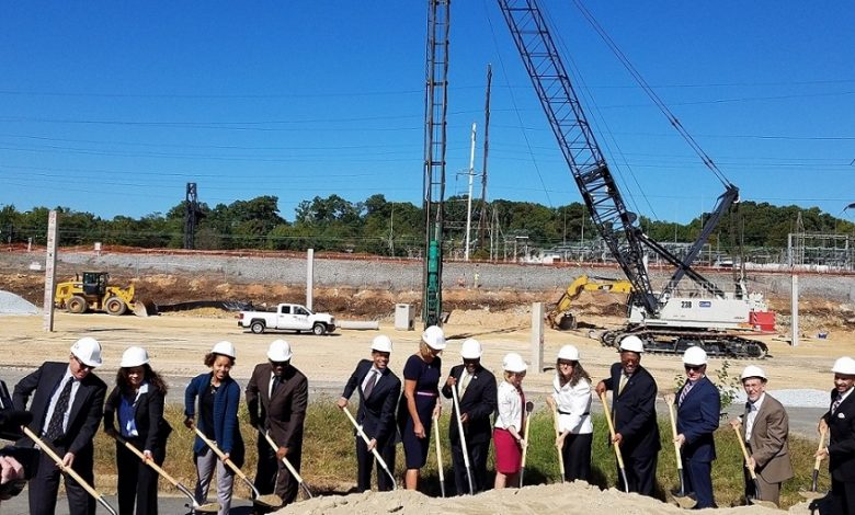 Kaiser Permanente representatives join local and Metro officials for an Oct. 4 groundbreaking ceremony in New Carrollton, Maryland, for Kaiser Permanente Mid-Atlantic States' 49-acre complex near the New Carrollton Metro station. (William J. Ford/The Washington Informer)