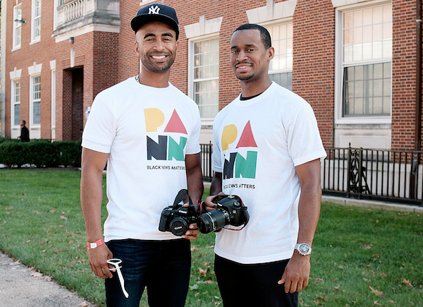 Quincy Ewell (left) and Darren Harris, Howard University alumni and founders of the Pan African News Network (PANN) application, attend Howard's homecoming festivities in Northwest on Oct. 21. (Michael A. McCoy/The Washington Informer)