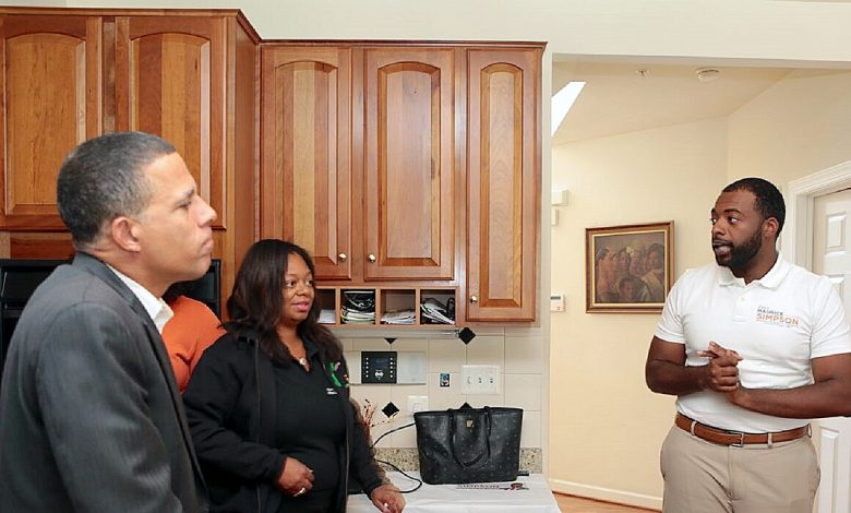 Maurice Simpson (right) speaks during a Sept. 30 meet-and-greet in Springdale while County Councilwoman Karen Toles (center) and Rep. Anthony Brown (D-Md.) listen. (Demetrious Kinney/The Washington Informer)