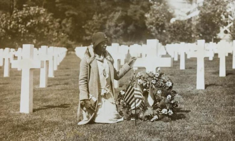"""A pilgrim of Party """"L"""" at Suresnes American Cemetery, Suresnes, France-July 26, 1930. (National Archives, College Park)"""