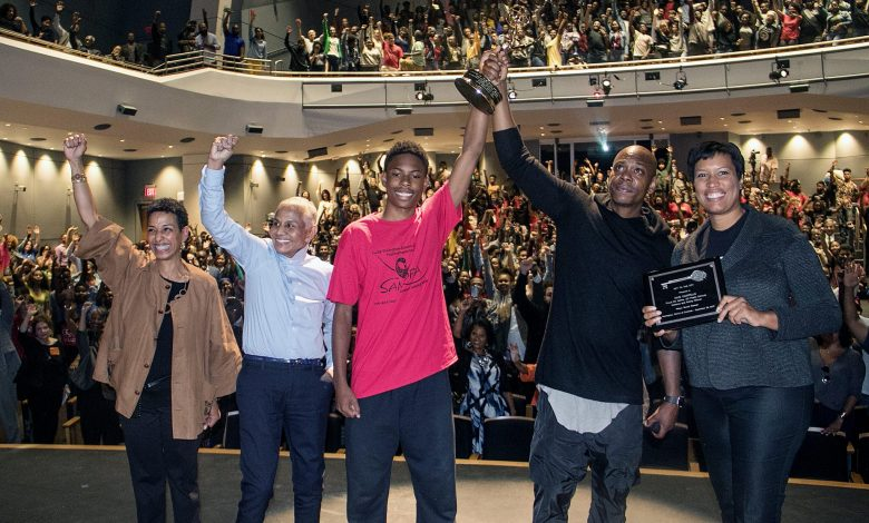 "From left: Duke Ellington School of the Arts Chief Executive Officer Tia Powel Harris, Peggy Cooper Cafritz, co-founder of the Duke Ellington School of the Arts and former president of D.C.'s school board, Ellington freshman Makeal Exum, comedian Dave Chappelle and D.C. Mayor Muriel Bowser lift hands in celebration at the Northwest school on Sept. 29, after Chappelle was presented with the Key to the City and gifted the school with an Emmy he received for an appearance on ""Saturday Night Live"" earlier this year. (Shevry Lassiter/The Washington Informer)"
