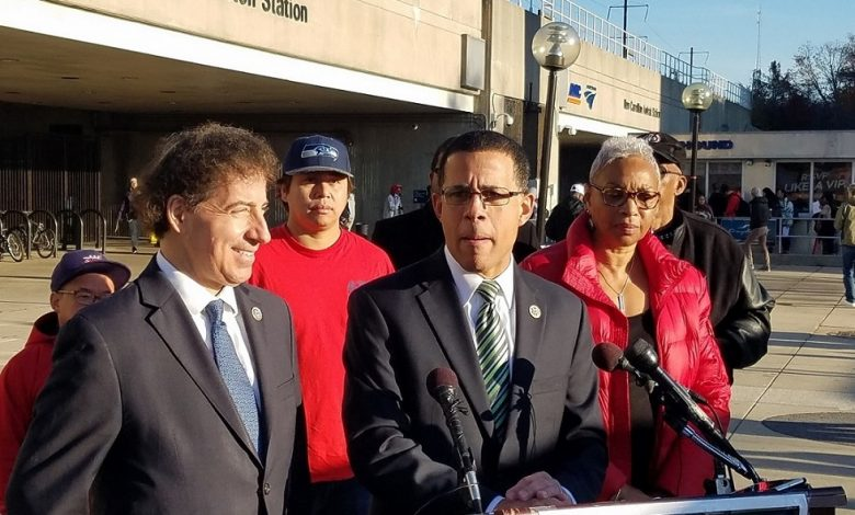 Maryland Reps. Anthony Brown (at podium) and Jamie Raskin present legislation they say will improve Metro during a Nov. 28 press conference outside the New Carrollton Metro station. Amalgamated Transit Union Local 689 President Jackie Jeter (right) also spoke during the conference. (William J. Ford/The Washington Informer)