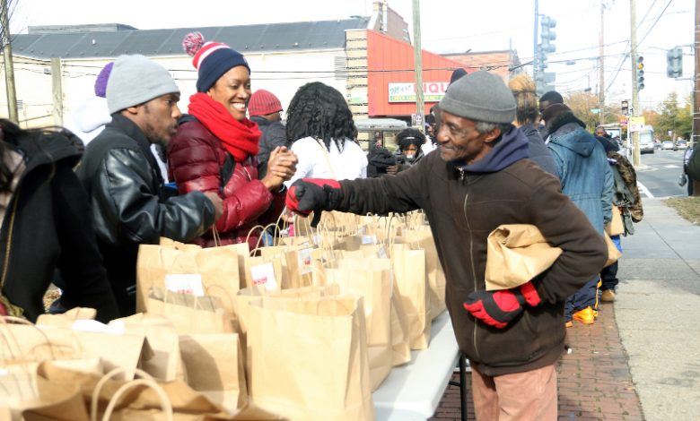 """Residents participate in """"Community Clean Up Day"""" in Ward 8 on Nov. 10. (Shevry Lassiter/The Washington Informer)"""