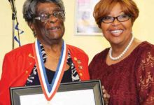 Photo of Veterans Volunteer Presented Award for Service