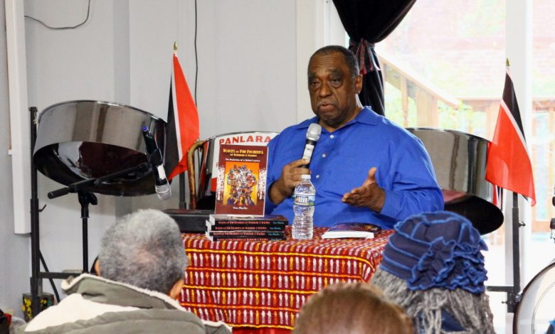"Dozens gather at Sankofa bookstore in Northwest for a Nov. 19 public forum on Caribbean music, based on the new book ""Voices of Pan Pioneers of Trinidad & Tobago: A Global Legacy"" by historian Von Martin. (E Watson/EDI Photo)"