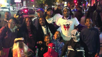 Ward 8 Council member Trayon White leads a community walk in Southeast to promote safety and nonviolence for children in Southeast on Oct. 31. (Courtesy photo)