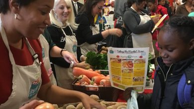 D.C. Mayor Muriel Bowser participates in Hendley Elementary School's food distribution program. (Courtesy of Born This Way Foundation via Twitter)