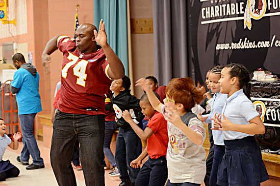 Members of the Washington Redskins and the team's charitable foundation visit students at Kingsford Elementary School. (Courtesy of PGCPS)