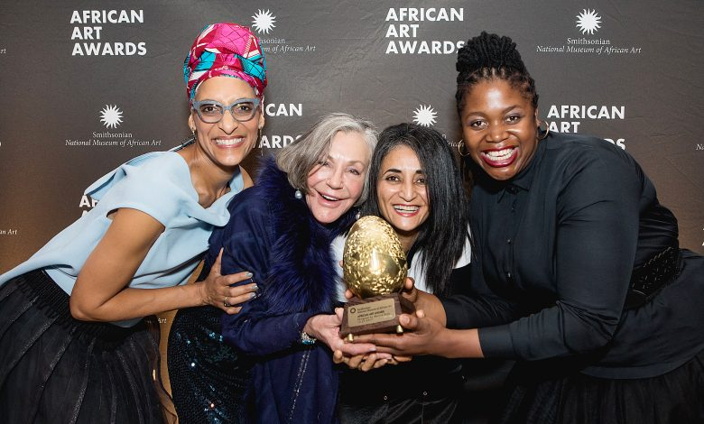 From left: Celebrity chef Carla Hall poses for a photo with philanthropist Alice Walton and artists Ghada Amer and Mary Sibande during the Smithsonian National Museum of African Art's second annual African Art Awards Dinner at the Smithsonian Arts & Industries Building in northwest D.C. on Oct. 27. (Courtesy of Cheriss May)