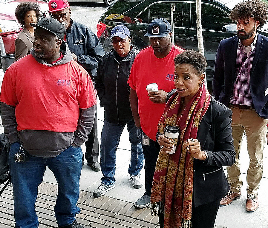 Former Maryland Rep. Donna Edwards (right) chats with members of the Amalgamated Transit Union Local 689 and other union representatives outside Metro headquarters in northwest D.C. on Oct. 26. Edwards, who's running for Prince George's County executive, came out to support the Metro workers' push for additional safety measures within the transit system. (William J. Ford/The Washington Informer)