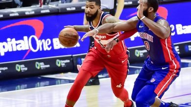Washington Wizards power forward Markieff Morris (5) attempts to drive past Detroit Pistons center Andre Drummond in the first quarter of the Wizards' 109-91 victory at Capital One Arena in D.C. on Dec. 1. (Yusuf Abdullah)
