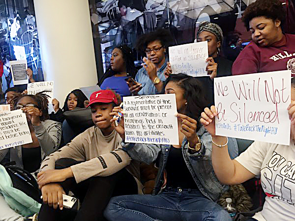 **FILE** Protesters against Howard University's treatment of sexual assault victims gather at the entrance of the university's College Hall South Dorm, where an alleged attacker worked as a resident assistant, on March 23, 2016. (Courtesy photo)