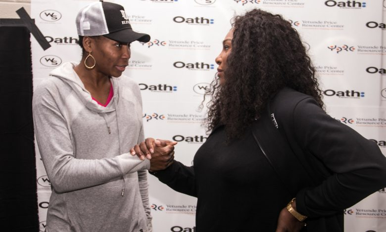 "Tennis legends and sisters Venus (left) and Serena Williams host ""A Family Affair"" event at the Southeast Tennis and Learning Center in D.C. on Dec. 4. (Shevry Lassiter/The Washington Informer)"