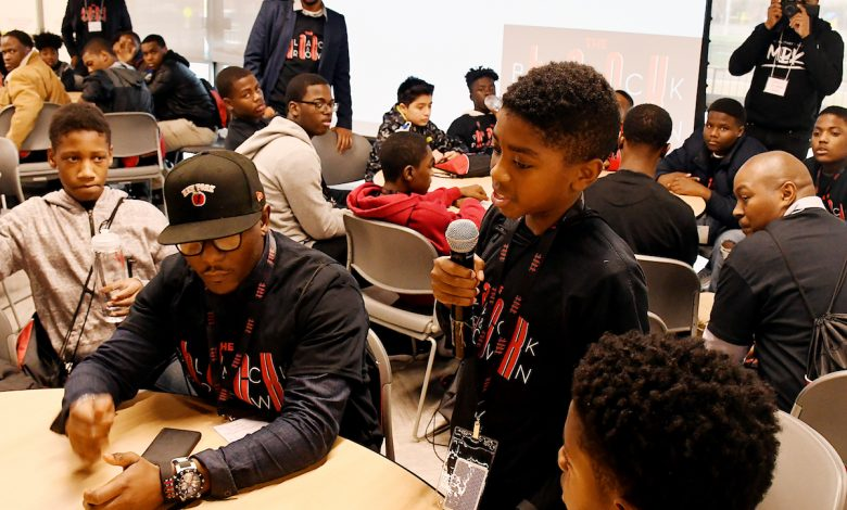"Students and volunteers participate in the inaugural ""Black and Brown Hackathon"" at Ron Brown College Preparatory High School in D.C. on Oct. 2. (Roy Lewis/The Washington Informer)"