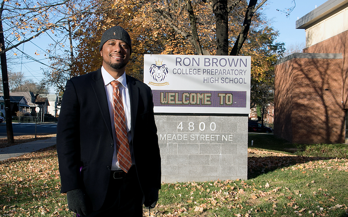 Benjamin Williams stands in front of Ron Brown College Preparatory High School in southeast D.C. (Shevry Lassiter/The Washington Informer)