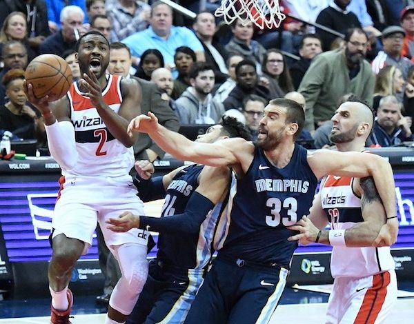 Washington Wizards guard John Wall goes up for a layup over Memphis Grizzlies guard Dillon Brooks (24) and center Marc Gasol in Washington's 93-87 victory at Capital One Arena in D.C. on Dec. 13. (John De Freitas/The Washington Informer)
