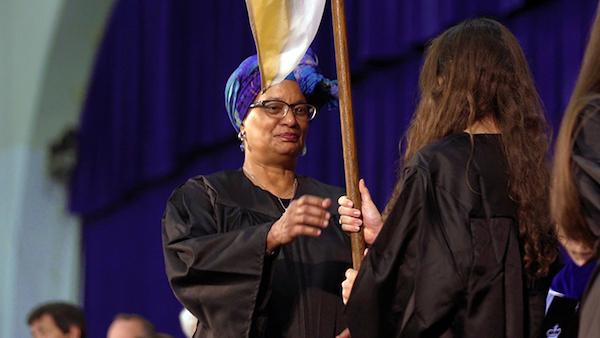 Mélisande Short-Colomb takes the Georgetown College banner as she becomes a member of the Class of 2021 during a convocation ceremony on Aug. 27. (Courtesy of Georgetown University)