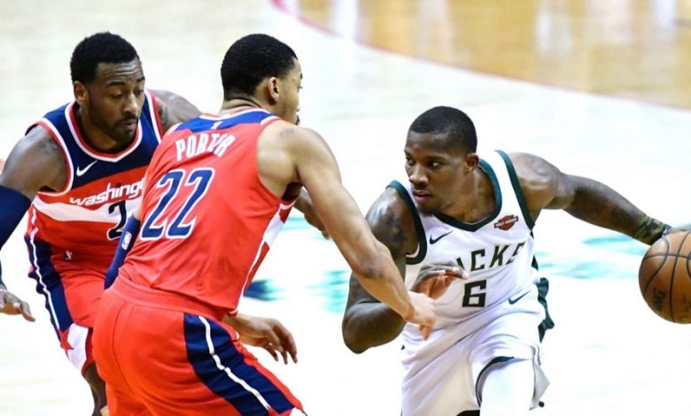 Milwaukee Bucks guard Eric Bledsoe tries to dribble around Washington Wizards forward Otto Porter Jr. (22) and guard John Wall in the third quarter of Milwaukee's 104-95 win at Capital One Arena in D.C. on Jan. 15. (John De Freitas/The Washington Informer)