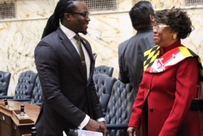 Delegates Alonzo Washington (left) and Carolyn J. B. Howard, who both represent Prince George's County, chat Jan. 10 after the first day of the Maryland General Assembly session adjourned. (Brigette White/The Washington Informer)